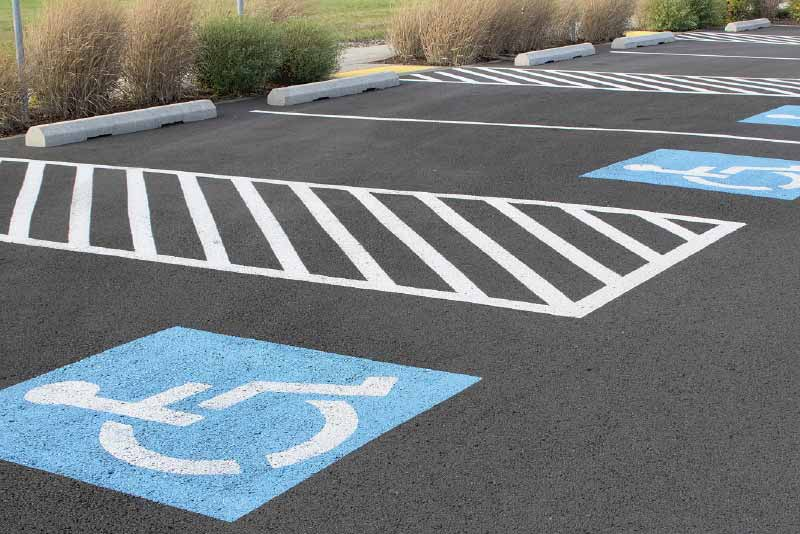 Painted stripes and handicap symbol in parking lot